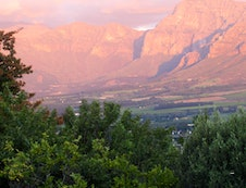 View from Alba House of mountains at sunset