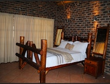 MAIN BEDROOM IN THATCH ROOF HOUSE