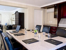 Executive boardroom with private lounge
