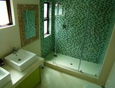 Bathroom downstairs with double shower, toilet and double washbasin