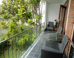 Private covered street-facing balcony