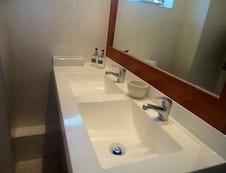 Bathroom with bath, shower and twin basins