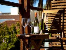 Enjoy a glass of wine on the balcony