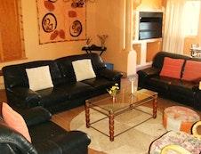 Indoor braai area and sitting room