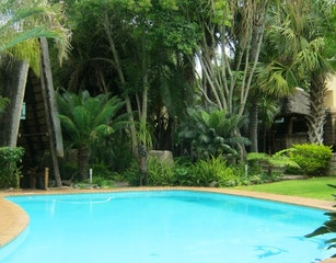 Set in Beautifull gardens with sparkling pool.