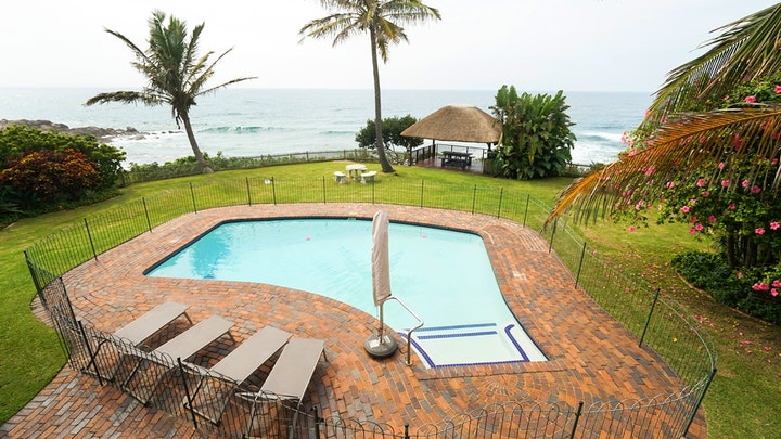 Shaka's Rock Accommodation at Nomax Beach House | TravelGround